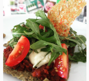 Detox Delight raw salad with tomatoes and spicy cracker