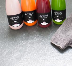 Detox Delight Active Delight juices with grey towel